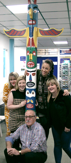 Students with the totem pole