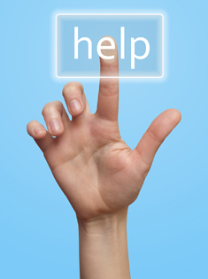 A hand pushing a Help button