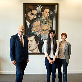Soniya Ahmed standing beside picture with Nigel Cooke, Director of One Nottingham and Mandi Chandler, Curriculum Manager for Art & Design at Central College Nottingham